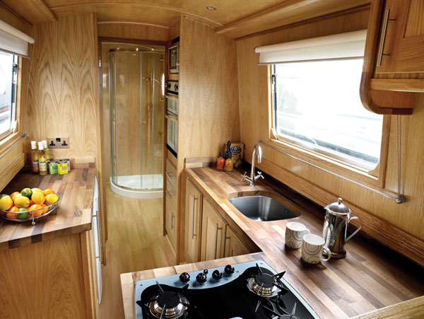 The new and used boat company new boats narrowboat for Boat galley kitchen designs