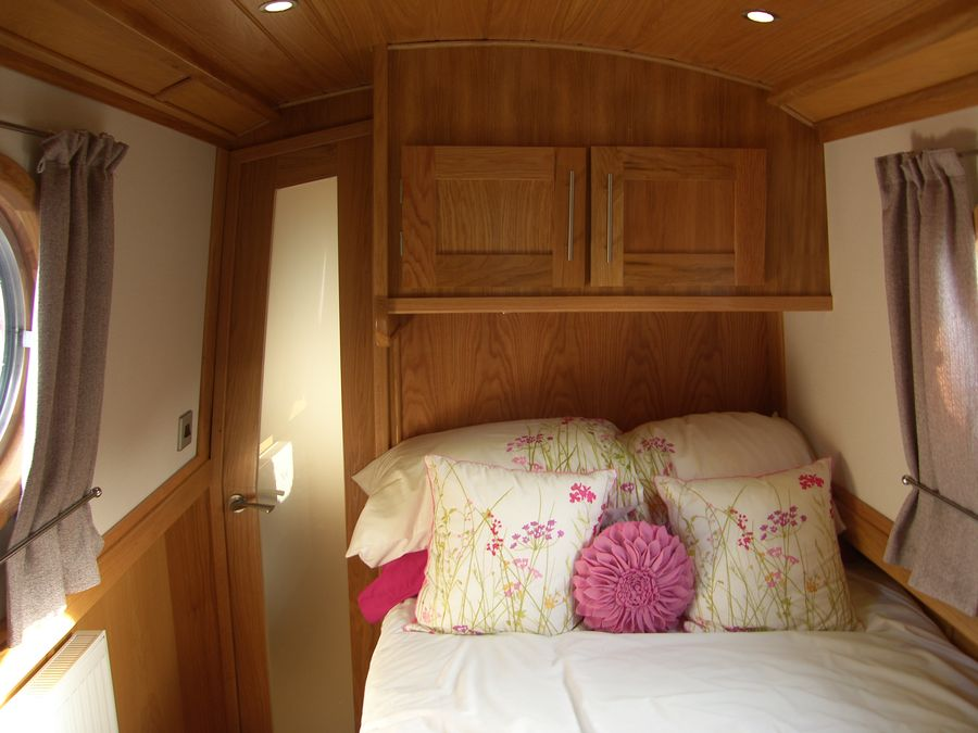 Forward bedroom has fixed double berth with lots of space underneath for storage