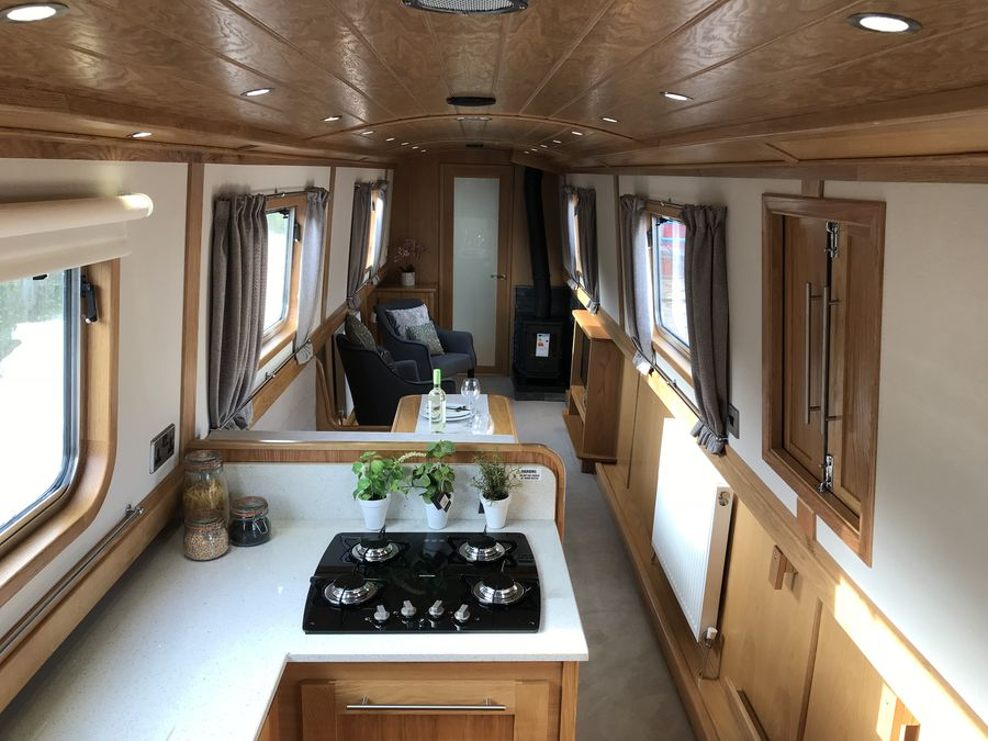 Open plan aft galley saloon works well with minimal clutter adding to spacious feeling